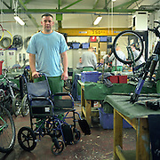 One of the inamtes with his reconditioned wheelchair at the  Inside Out trust workshop.