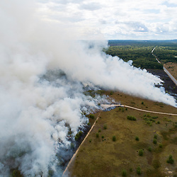 An aerial view of a prescribed burn on the grassland at The Nature Conservancy's Kennebunk Plains Preserve in Kennebunk, Maine.