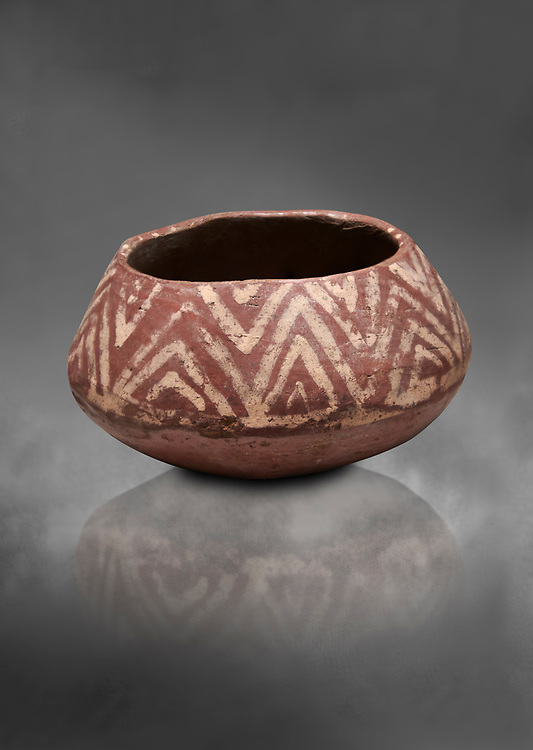 Ancient Egyptian decorated mari ware, class D, baked clay, Predynastic Period, Naqada II Protodynastic Period (3700-300 BC). Egyptian Museum, Turin. Grey Background<br /> <br /> Mari was a new raw material used to make vases from Naqada II onwards. The material was a marl of rich clay found in some ancient Egyptian desert site which was pulverised and mixed with water. Typically the pottery had a rosy sinish when fired making a good background for painted motifs. .<br /> <br /> If you prefer to buy from our ALAMY PHOTO LIBRARY  Collection visit : https://www.alamy.com/portfolio/paul-williams-funkystock/ancient-egyptian-art-artefacts.html  . Type -   Turin   - into the LOWER SEARCH WITHIN GALLERY box. Refine search by adding background colour, subject etc<br /> <br /> Visit our ANCIENT WORLD PHOTO COLLECTIONS for more photos to download or buy as wall art prints https://funkystock.photoshelter.com/gallery-collection/Ancient-World-Art-Antiquities-Historic-Sites-Pictures-Images-of/C00006u26yqSkDOM