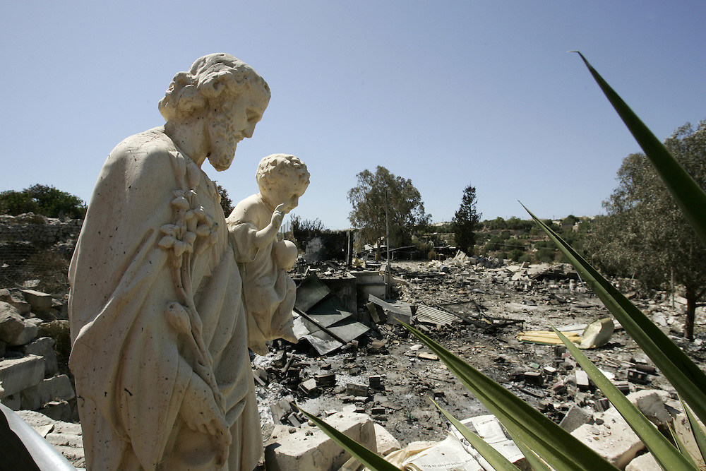 A statue of Saint Joseph and Jesus stands unscathed in the ruins of the St Joseph's Fireworks Factory in the village of Zebbug, outside Valletta, July 5, 2005.  The factory exploded the previous day, leaving two people dead and two others fighting for their lives.  Fireworks are an essential part of Maltese traditional celebrations for village patron saints' feast days...MALTA OUT..REUTERS/Darrin Zammit Lupi