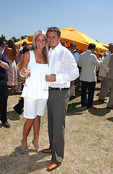 Actress JENNIFER ELLISON and TONY RICHARDSON at the Veuve Clicquot sponsored Gold Cup Final or the British Open Polo Championship held at Cowdray Park, West Sussex on 17th July 2005.<br />