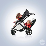 Playful twins photographed modelling a Britax double pushchair product