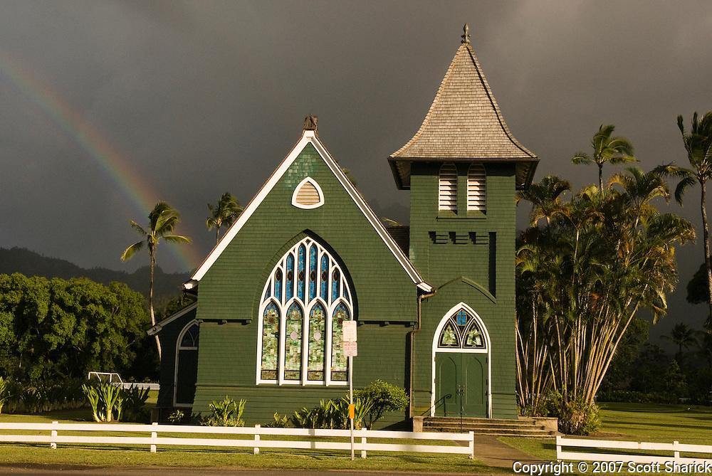 A rainbow stretches behind the Wai'oli Hui'ia Church in Hanalei, Kauai, Hawaii.