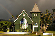 A rainbow stretches behind the Wai'oli Hui'ia Church in Hanalei, Kauai, Hawaii.