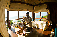 Therapist giving a massage, Six Senses Spa, Six Senses Hideaway (resort hotel), Koh Samui (island), Gulf of Thailand, Thailand