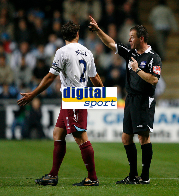 Photo: Steve Bond.<br />Coventry City v West Ham United. Carling Cup. 30/10/2007. Referee Rob Styles (R) gives a final warning to Lucas Neill (R)