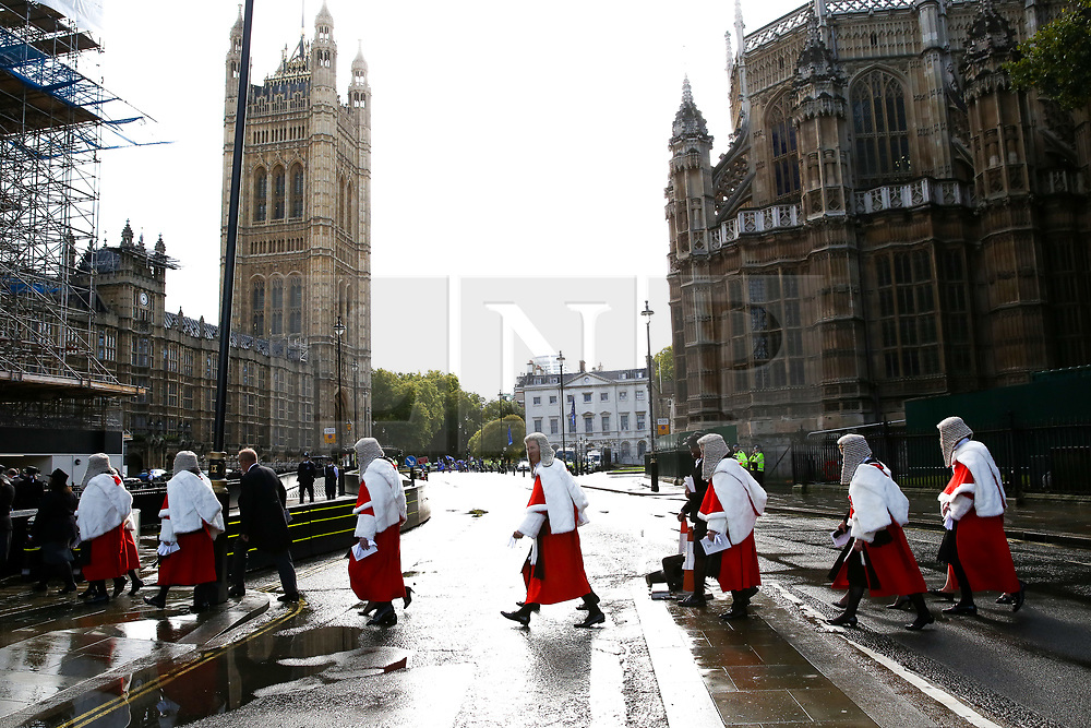 © Licensed to London News Pictures. 01/10/2019. London, UK. High Court Judges leave Westminster Abbey for The Houses of Parliament after attending the annual service to mark the start of the legal year. The start of the new legal year is marked with a traditional religious service in Westminster Abbey followed by a procession to The Houses of Parliament where the Lord Chancellor (Justice Secretary) hosts a reception.   Photo credit: Dinendra Haria/LNP