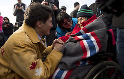 Prime Minister Justin Trudeau greets an elder following a ceremony near Chilko Lake, B.C.,Friday, Nov. 2, 2018. The Prime Minister was in the area to apologize to the Tsilhqot'in community for the hangings of six chiefs during the so-called Chilcotin War over 150 years ago. Photo by The Canadian Press /Jonathan Hayward/ABACAPRESS.COM