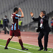 Trabzonspor's Murat TOSUN (L) celebrate his goal with coach Senol GUNES (R) during their Turkish superleague soccer match Trabzonspor between Denizlispor at the Avni Aker Stadium in Trabzon Turkey on Monday, 10 May 2010. Photo by TURKPIX