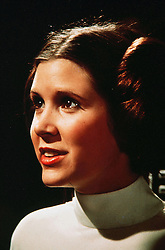 December 27, 2016 - File - CARRIE FRANCES FISHER (October 21, 1956 - December 27, 2016) was an American actress, screenwriter, author, producer, and speaker. She was known for playing Princess Leia in the Star Wars films. Fisher was also known for her semi-autobiographical novels, including Postcards from the Edge, and the screenplay for the film of the same name, as well as her autobiographical one-woman play, and its nonfiction book, Wishful Drinking, based on the show. Her other film roles included Shampoo (1975), The Blues Brothers (1980), Hannah and Her Sisters (1986), The 'Burbs (1989), and When Harry Met Sally (1989). Pictured: April 29, 2014 - Original Star Wars actors Harrison Ford, Carrie Fisher and Mark Hamill will feature in Star Wars: Episode VII, the latest film in the franchise. Other actors confirmed are Andy Serkis and Max von Sydow, alongside relative newcomers John Boyega and Daisy Ridley, both of whom are British. Episode VII will start shooting at Pinewood Studios, near London, in May. Anthony Daniels, Peter Mayhew and Kenny Baker will also return as C-3PO, Chewbacca and R2-D2 respectively. PICTURED: Star Wars: Episode VI - Return of the Jedi Movie still. RELEASE DATE: May 25, 1977  PICTURED: CARRIE FISHER as Princess Leia Organa. (Credit Image: © Lucas Films/Entertainment Pictures/ZUMAPRESS.com)