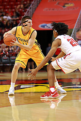 05 November 2016:   Robby Dosier guarded by Madison Williams(25) during an NCAA  mens basketball game where the Quincy Hawks lost to the Illinois State Redbirds in an exhibition game at Redbird Arena, Normal IL
