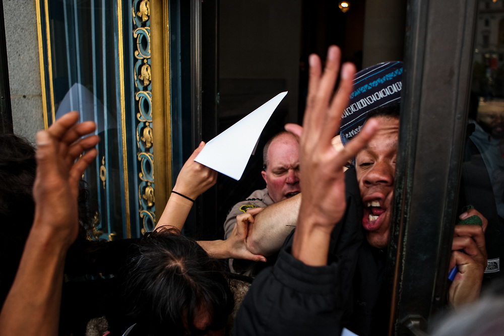 James Burch gets slammed by a San Francisco deputy sheriff after protestors stormed through the eastern entrance of City Hall in San Francisco, Calif., Friday, May 6, 2016.<br /> <br /> All doors to City Hall were locked during business hours after a group of protestors supporting the Frisco 5 marched inside the building and gathered outside the office of Mayor Ed Lee demanding the resignation of SFPD Chief Greg Suhr. A second group of protesters were let in after individuals from the group inside walked towards the eastern entrance of the building and opened the doors to others waiting outside.