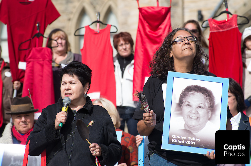 People gathered on Parliament Hill for an annual vigil remembering missing and murdered Aboriginal women. There were several speakers, some of which shared stories of violence against themselves or murdered relatives. Others called on candidates in the upcoming federal election to make murdered and missing Aboriginal women a priority. October 4, 2015.
