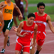 Sharyland's Gustavo Cantu pushes to the finish line in the last leg of the boys 4X100 relay as C.J. Cavasos cheers him on at the 30-5A District Track Meet in McAllen.<br /> Nathan Lambrecht/The Monitor