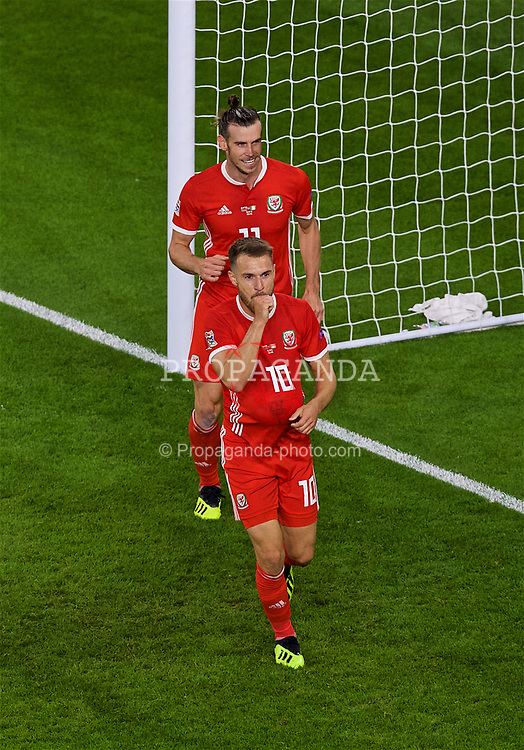 CARDIFF, WALES - Thursday, September 6, 2018: Wales' Aaron Ramsey (#10) celebrates scoring the third goal with team-mate Gareth Bale during the UEFA Nations League Group Stage League B Group 4 match between Wales and Republic of Ireland at the Cardiff City Stadium. (Pic by Laura Malkin/Propaganda)