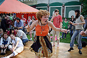 Moscow, Russia, 10/07/2004..Several thousand people attend ETNA, Russia's largest festival of ethnic and world music; this year's festival featured artists from four continents. .Dancing to Hungarian gypsy band Parno Graszt.