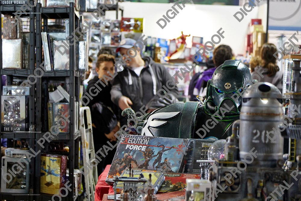 Milan, Italy - March 8 2019 Cartoomics Comic Con Memorabilia being sold and visitors browsing among items