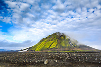 The mountain Mælifell presses upwards from the rocky deserts of Mælifellssandur to a height of 791 m.