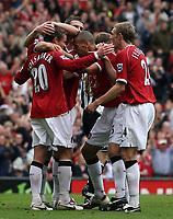 Photo: Paul Thomas.<br /> Manchester United v Newcastle United. The Barclays Premiership. 01/10/2006.<br /> <br /> Ole Gunnar Solskjaer (20) of Man Utd celebrates his goal with team mates.