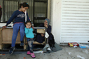 February 28, 2016 - Athens, Greece - <br /> <br /> Refugees and migrants at the disused facilities of the west terminal of the former Athens airport, at the Hellinikon south suburb of Athens. On Sunday February 28, 2016. The European Commission estimates that about 25,000 immigrants are in Greece and now stranded after the decision of the police forces of Slovenia, Austria, Macedonia, Serbia and Croatia to reduce the flow of immigrants to around 580 people a day. <br /> ©Exclusivepix Media