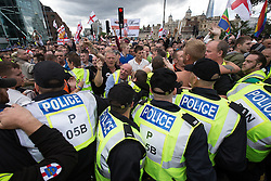 © Licensed to London News Pictures . 07/09/2013 . London , UK . Police hold back EDL supporters along the demonstration route . The EDL hold a march and demonstration in London today (Saturday 7th September 2013) . Photo credit : Joel Goodman/LNP