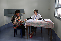 Phone 28 yrs old has brought his daughter Linda 1 yrs 6 months to the clinic as she had Diarrhoea. They are seen by Nurse Sompone. Nambac District Hospital, Luang Prabang Province, Lao PDR