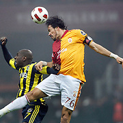 Galatasaray's Servet CETIN (R) and Fenerbahce's Mamadou NIANG (L) during their Turkish superleague soccer derby match Galatasaray between Fenerbahce at the Turk Telekom Arena in Istanbul Turkey on Friday, 18 March 2011. Photo by TURKPIX