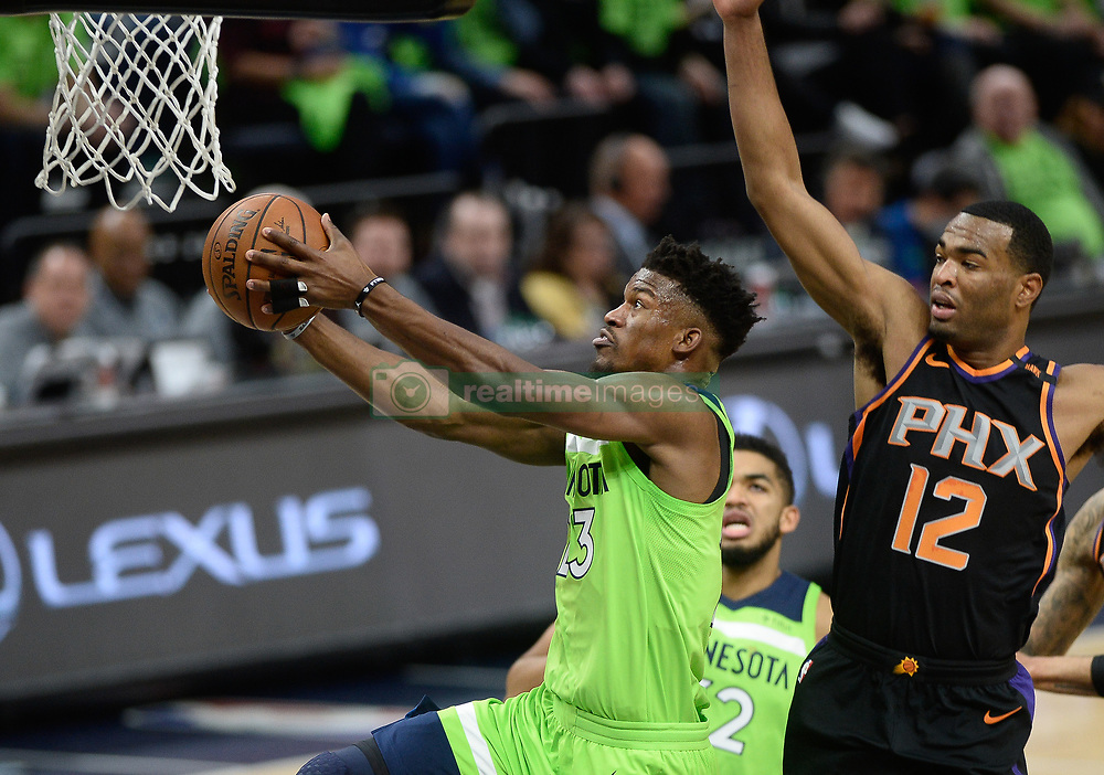 December 16, 2017 - Minneapolis, MN, USA - The Minnesota Timberwolves' Jimmy Butler (23) scores a layup in the first quarter with the Phoenix Suns' TJ Warren (12) in pursuit on Saturday, Dec. 16, 2017, at Target Center in Minneapolis. (Credit Image: © Aaron Lavinsky/TNS via ZUMA Wire)
