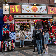 Chinese Gift & Crafts Shop in London Chinatown Sweet Tooth Cafe and Restaurant at Newport Court and Garret Street on 15 June 2019, UK.