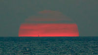 Sunset on the Baltic Sea. Are There Offshore Oil Platforms in the Baltic Sea Off Denmark? Image taken with a Nikon 1 V2 camera FT1 adapter and 80-400 mm VRII lens (ISO 400, 400 mm, f/5.6, 1/500 sec). Semester at Sea Spring 2013 Enrichment Voyage.