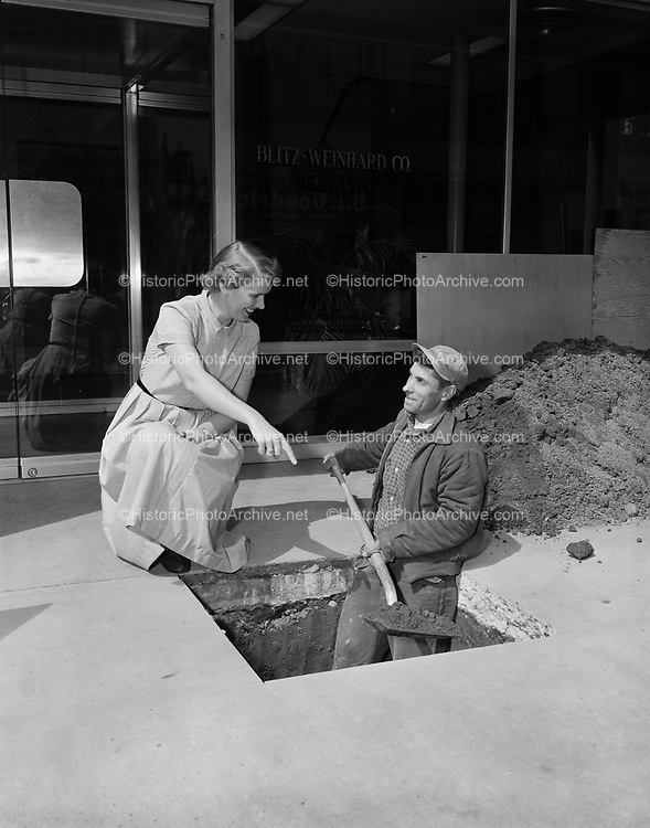 """Y-560511-01.  digging hole for Blitz time capsule. """"Under Construction. Vault for Blitz Weinhard 2nd Century Time Capsule. To be deposited 1:30 PM May 14, 1956. To be opened May 14, 2056."""""""