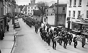 The St. patrick's Day parade makes its way up College Street, Killarney in the 1950's.<br /> Photo: macmonagle.com archive<br /> <br /> Killarney Now & Then - MacMONAGLE photo archives.<br /> Facebook - @killarneynowandthen