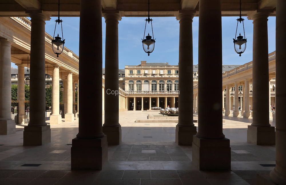 Galerie d'Orleans, with the Fontaine des Spherades or Mirror Ball Fountain, 1985, by Pol Bury, at the Palais-Royal, designed in 1629 by Jacques Lemercier for Cardinal Richelieu, then royal palace for Louis XIII, and now a ministry, in the 1st arrondissement of Paris, France. The building and its Place du Palais-Royal are listed as historic monuments. Picture by Manuel Cohen