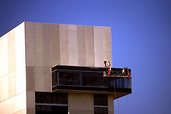 Stock photo of workmen on a lift during new construction at the Hilton Hotel in Houston, Texas