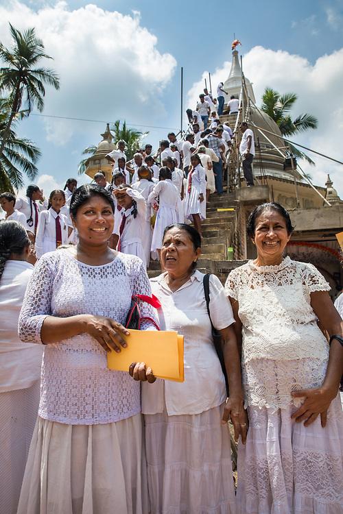 Worshippers make offerings to Buddha at the opening of a new buddha stupa, Ratnapura, Sri Lanka