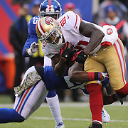 Anquan Boldin, San Francisco 49ers, is tackled by Antrel Rolle, New York Giants, during the New York Giants V San Francisco 49ers, NFL American Football match at MetLife Stadium, East Rutherford, NJ, USA. 16th November 2014. Photo Tim Clayton