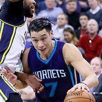 27 January 2016: Charlotte Hornets guard Jeremy Lin (7) drives past Utah Jazz forward Trevor Booker (33) during the Utah Jazz 102-73 victory over the Charlotte Hornets, at the Vivint Smart Home Arena, Salt Lake City, Utah, USA.