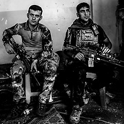 Iraqi Special Forces hold at a position before waiting to advance on the remaining pockets of ISIS resistance in the Old City of Mosul days after the Islamic militant group was declared defeated on Sunday July 2, 2017.