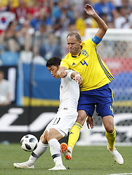 (L-R) Heechan Hwang of Korea Republic, Andreas Granqvist of Sweden during the 2018 FIFA World Cup Russia group F match between Sweden and Korea Republic at the Novgorod stadium on June 18, 2018 in Nizhny Novgorod, Russia