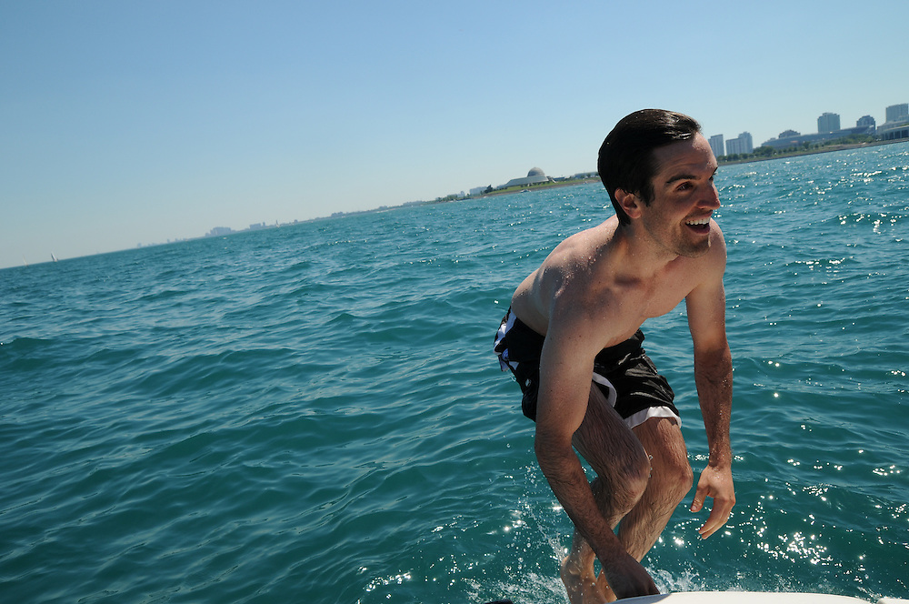"""Friends of Nick Gauen are aboard his """"Liquid Assets"""" pleasure boat on Lake Michigan for a cruise from Diversey Harbor and a swim in Monroe Harbor on the Fourth of July weekend."""