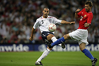 Photo: Rich Eaton.<br /> <br /> England v Russia. UEFA European Championships Qualifying. 12/09/2007. England's Rio Ferdinand (L) clears