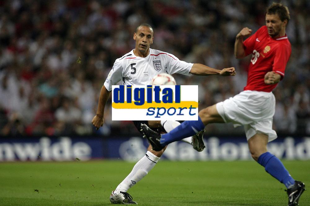 Photo: Rich Eaton.<br /> <br /> England v Russia. UEFA European Championships Qualifying. 12/09/2007. England's Rio Ferdinand (L) clears