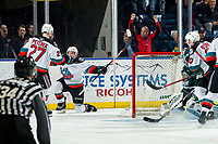 KELOWNA, BC - FEBRUARY 28:  Mark Liwiski #9 gets up off the ice to celebrate with Jonas Peterek #27 of the Kelowna Rockets after scoring a third period goal on Dustin Wolf #32 of the Everett Silvertips at Prospera Place on February 28, 2020 in Kelowna, Canada. (Photo by Marissa Baecker/Shoot the Breeze)