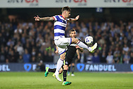 Queens Park Rangers defender Grant Hall (4) clears during the EFL Sky Bet Championship match between Queens Park Rangers and Brighton and Hove Albion at the Loftus Road Stadium, London, England on 7 April 2017.