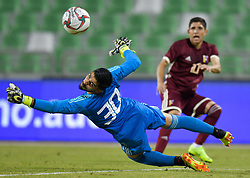 Jefferson Savarino (R) of Venezuela vies for the ball with Iran's goalkeeper Amir Abedzadeh (L) during the international friendly soccer match between Iran and Venezuela at Al Ahli Stadium Doha, Capital of Qatar, November 20, 2018. The match ended with a 1-1 draw. (Credit Image: © Nikku/Xinhua via ZUMA Wire)