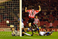Photo. Jed Wee.<br /> Sunderland v Ipswich Town, Nationwide League Division One, Stadium of Light, Sunderland. 30/09/2003.<br /> Sunderland's Gary Breen (C) equalises for Sunderland after leaving Ipswich goalkeeper Kelvin Davis on his back side.