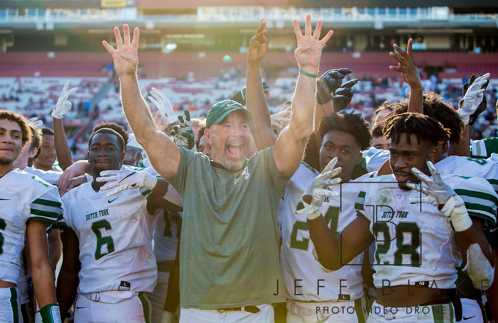 Dutch Fork Silver Foxes head coach Tom Knotts celebrates after the Class AAAAA State Championship Game at Williams-Brice Stadium in Columbia, SC. Dutch Fork Silver Foxes won 34-31. Dutch Fork wins their 4th straight state championship at Williams Brice Stadium. Photos ©JeffBlakePhoto.com