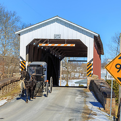 East Earl, PA - January 28, 2015: An Amish buggy exits the Weaver Mill Covered Bridge in Lancaster County, Pennsylvania.