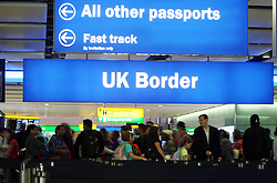 Embargoed to 0001 Monday June 5 File photo dated 22/07/15 of passengers going through the UK Border at Terminal 2 of Heathrow Airport. Fewer than a quarter of voters would back Theresa May's plan to cut immigration below 100,000 if they thought it would mean public spending cuts, higher taxes or a later retirement age, according to a new poll.