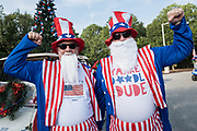 Men dressed in Uncle Sam costumes at the annual Independence Day golf cart and bicycle parade July 4, 2019 in Sullivan's Island, South Carolina. The tiny affluent Sea Island beach community across from Charleston holds an outsized golf cart parade featuring more than 75 decorated carts.